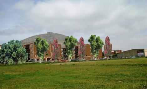 Blocs de Ullà camuflats amb arbres i color. Foto. L.A.